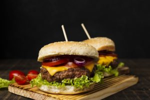 burgers-cutboard-with-black-background_23-2148273011.jpg