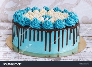 stock-photo-birthday-cake-with-cream-chocolate-drips-on-a-white-background-588794339.jpg